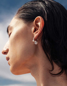Quarry brass and pearl Bua Earring on model. Available at FAWN Toronto.