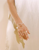 Load image into Gallery viewer, Model wears Corey Moranis Loop Ring in Clear. Available at FAWN Toronto.