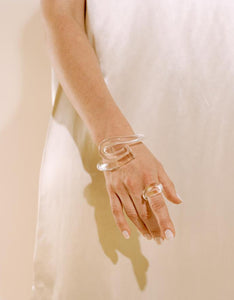 Model wears Corey Moranis Loop Ring in Clear. Available at FAWN Toronto.