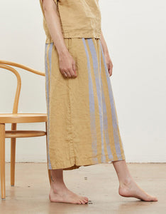 Model wears Black Crane Wide Culottes in Tan with Lavender Stripe, side. Available at FAWN Toronto.