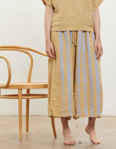 Model wears Black Crane Wide Culottes in Tan with Lavender Stripe. Available at FAWN Toronto.