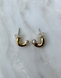 Quarry brass Gir Earring. Available at FAWN Toronto.