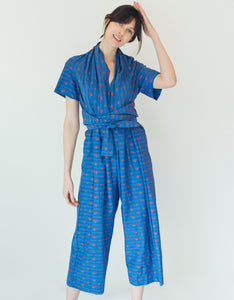Model wears Caron Callahan Josefina Jumpsuit in Blue Clipped Floral Pattern. Available at FAWN Toronto.