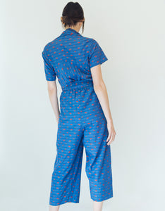 Model wears Caron Callahan Josefina Jumpsuit in Blue Clipped Floral Pattern, back. Available at FAWN Toronto.