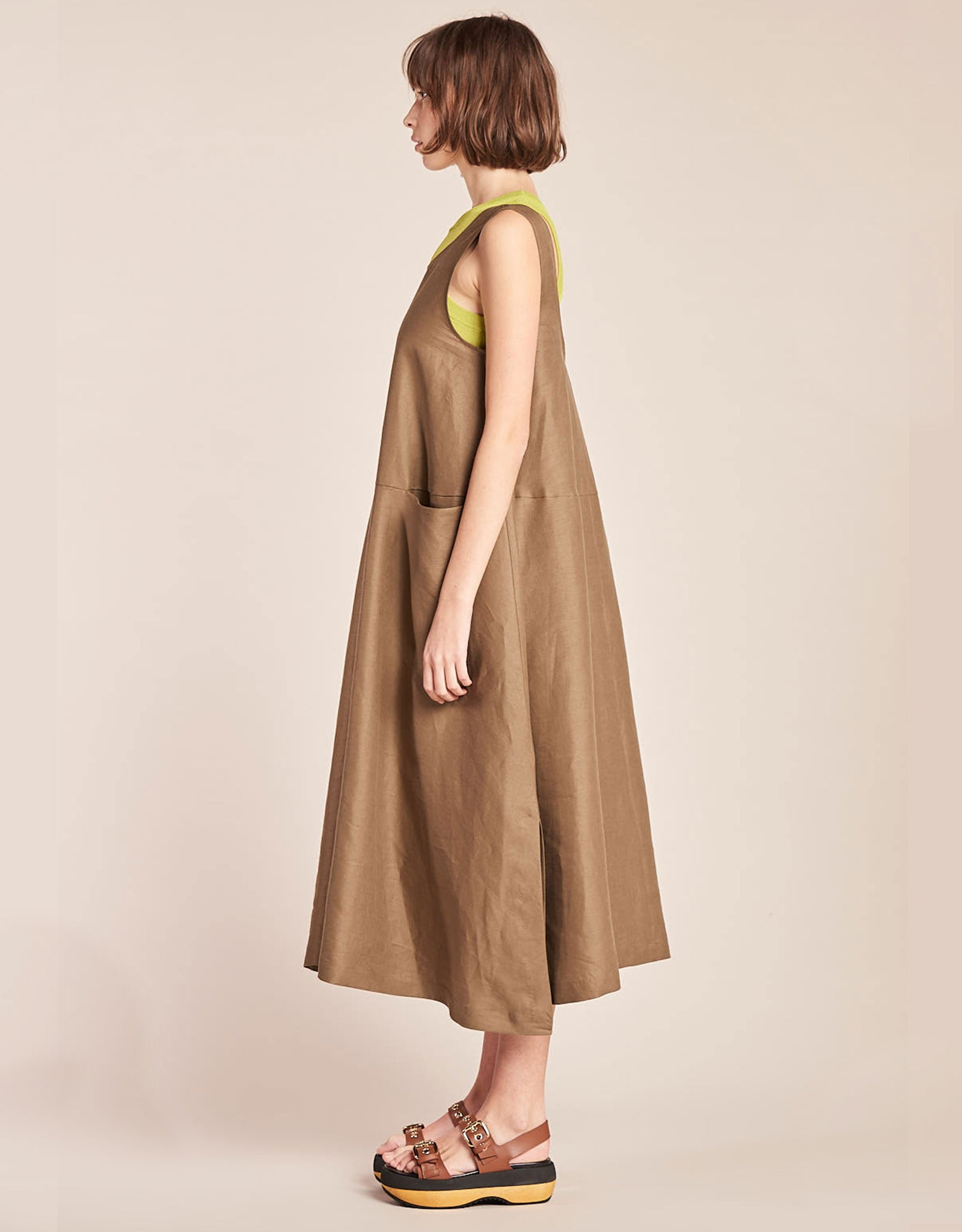Model wears Kloke Luna Dress in Tobacco, styled layered over tank, side. Available at FAWN Toronto.