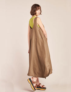 Model wears Kloke Luna Dress in Tobacco, styled layered over tank, back, in motion. Available at FAWN Toronto.