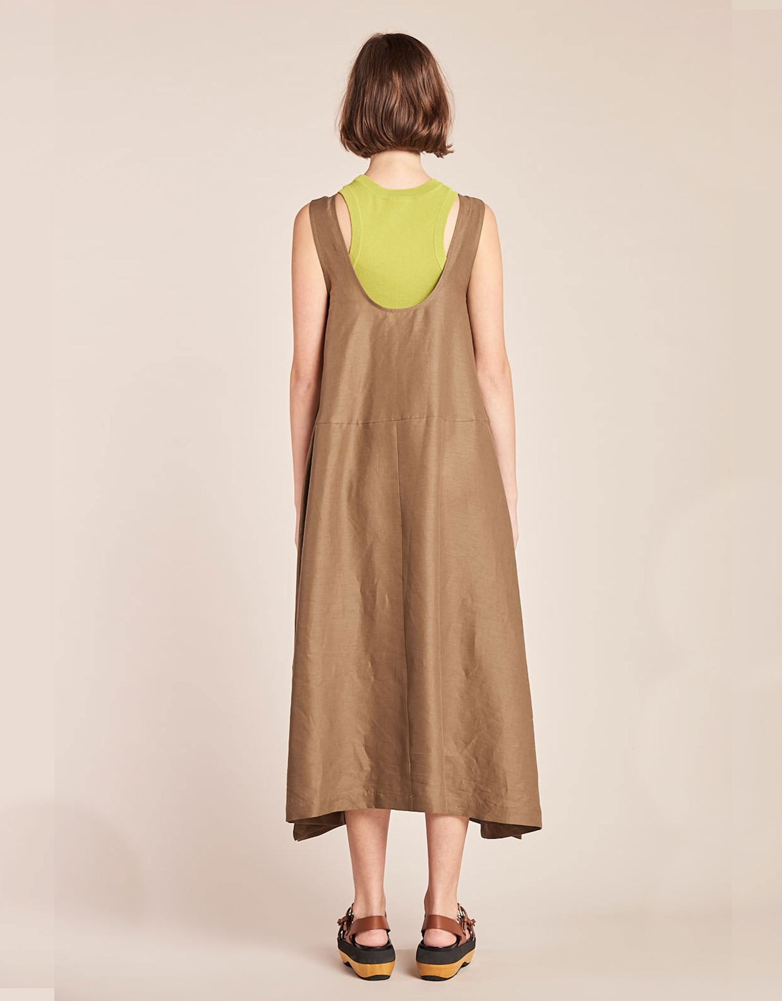 Model wears Kloke Luna Dress in Tobacco, styled layered over tank, back. Available at FAWN Toronto.