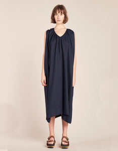 Model wears Kloke Crescent V-Neck Dress in Ink. Available at FAWN Toronto.