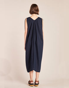 Model wears Kloke Crescent V-Neck Dress in Ink, back. Available at FAWN Toronto.