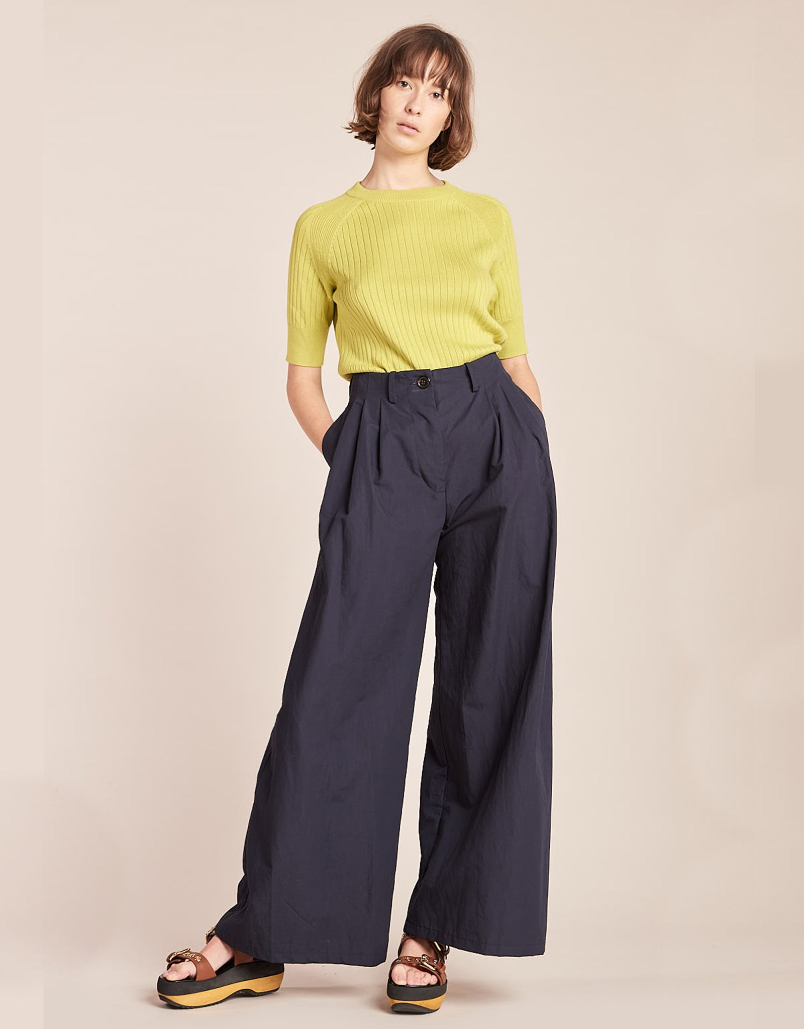 Model wears Kloke Illume Wide Pant in Ink, pocket detail. Available at FAWN Toronto.