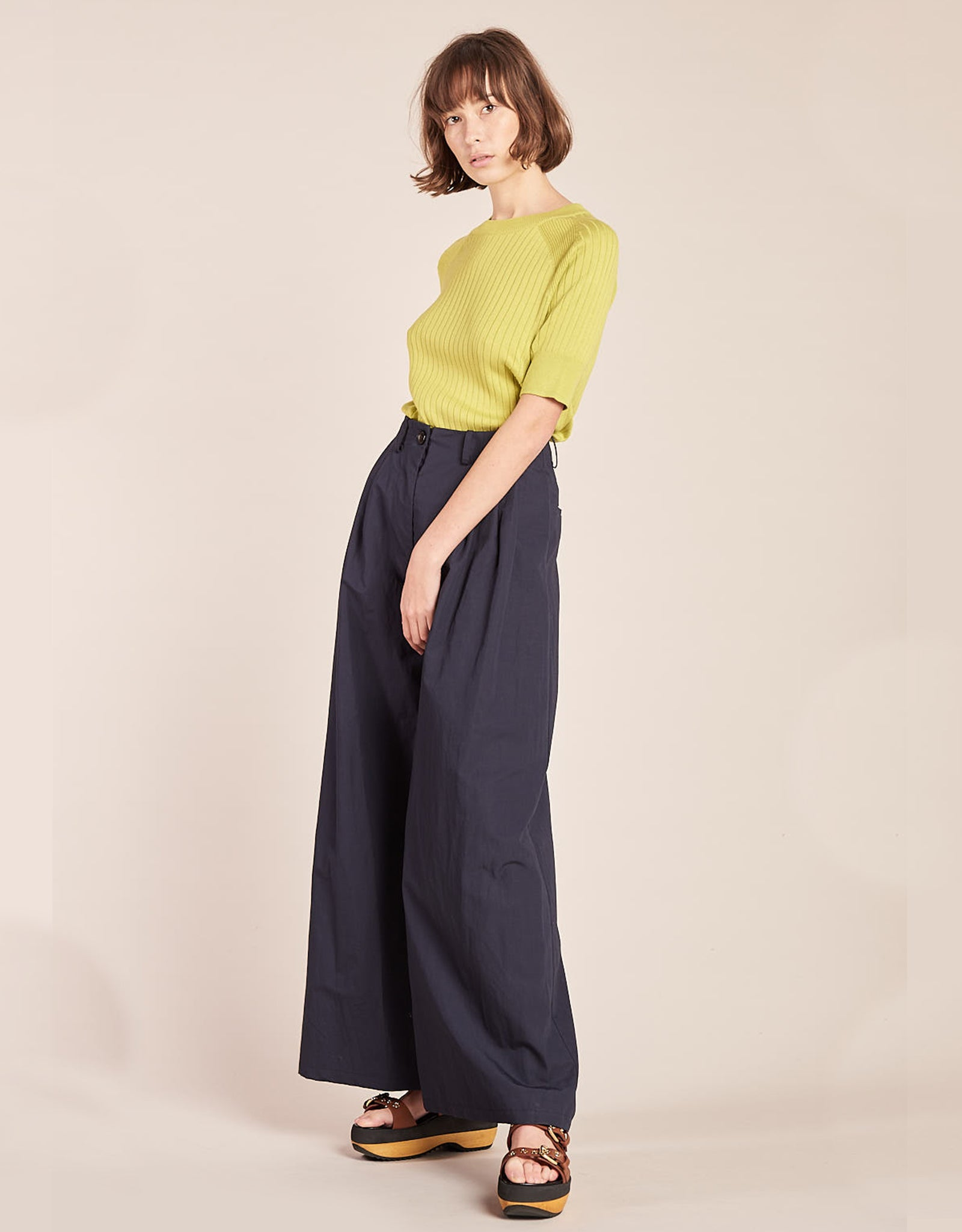 Model wears Kloke Illume Wide Pant in Ink, side. Available at FAWN Toronto.