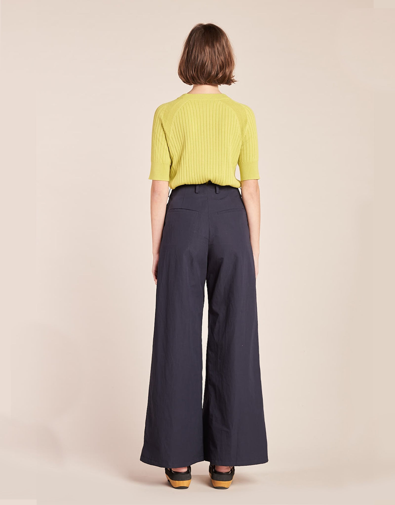 Model wears Kloke Illume Wide Pant in Ink, back. Available at FAWN Toronto.