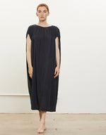 Load image into Gallery viewer, Model wears Black Crane Mont Blanc Dress in Faded Black. Available at FAWN Toronto.