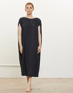 Model wears Black Crane Mont Blanc Dress in Faded Black. Available at FAWN Toronto.