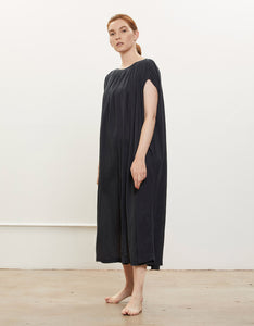 Model wears Black Crane Mont Blanc Dress in Faded Black, side. Available at FAWN Toronto.