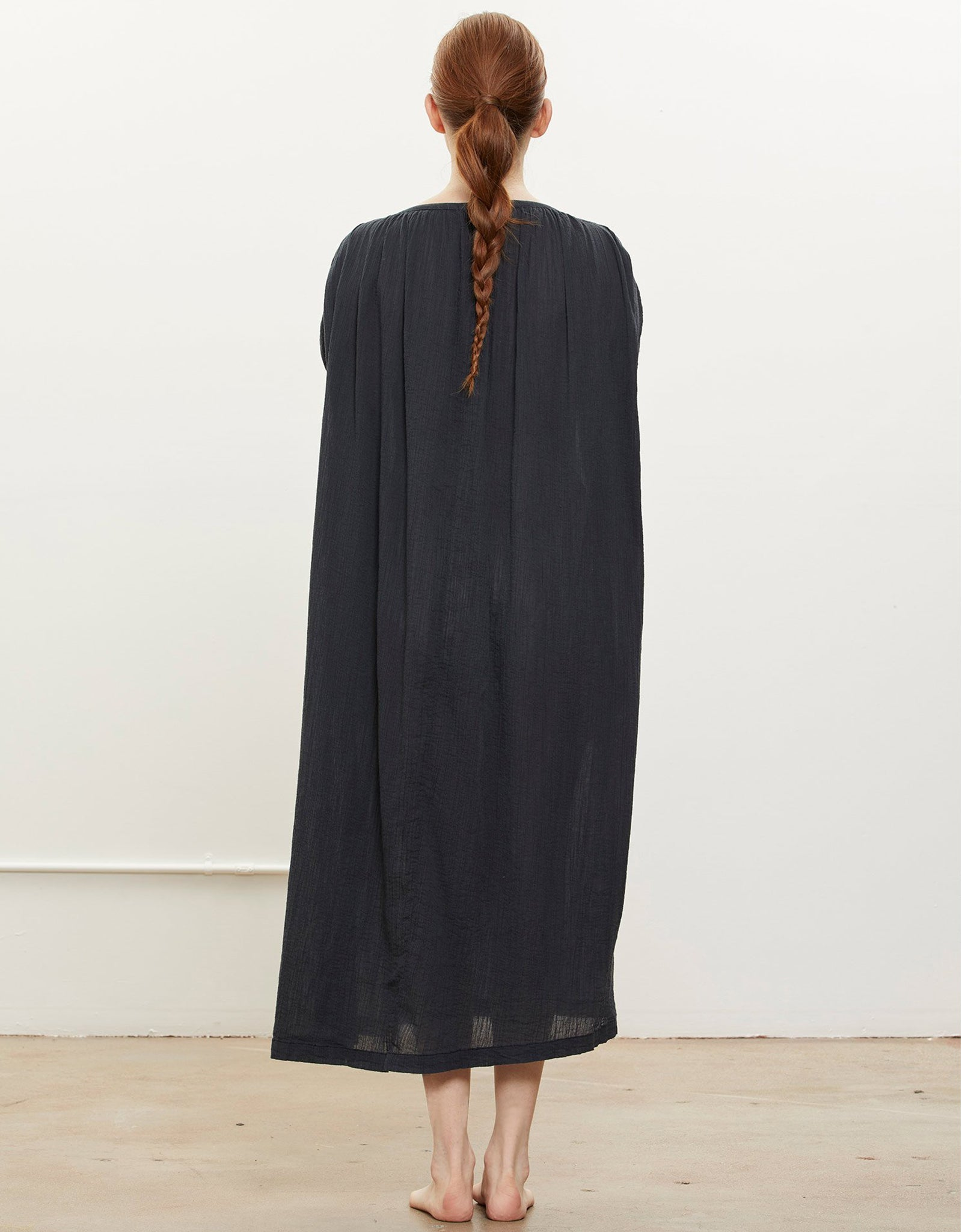 Model wears Black Crane Mont Blanc Dress in Faded Black, back. Available at FAWN Toronto.