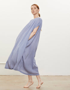 Model wears Black Crane Mont Blanc Dress in Lavender, side. Available at FAWN Toronto.
