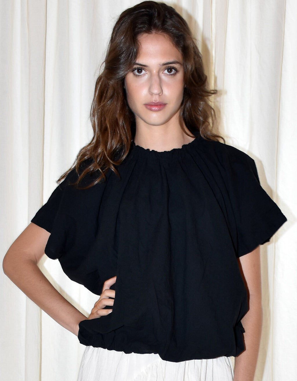 Model wears UZI NYC Nina Blouse in Black. Available at FAWN Toronto.