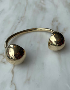 Quarry brass Opis Cuff, front. Available at FAWN Toronto.