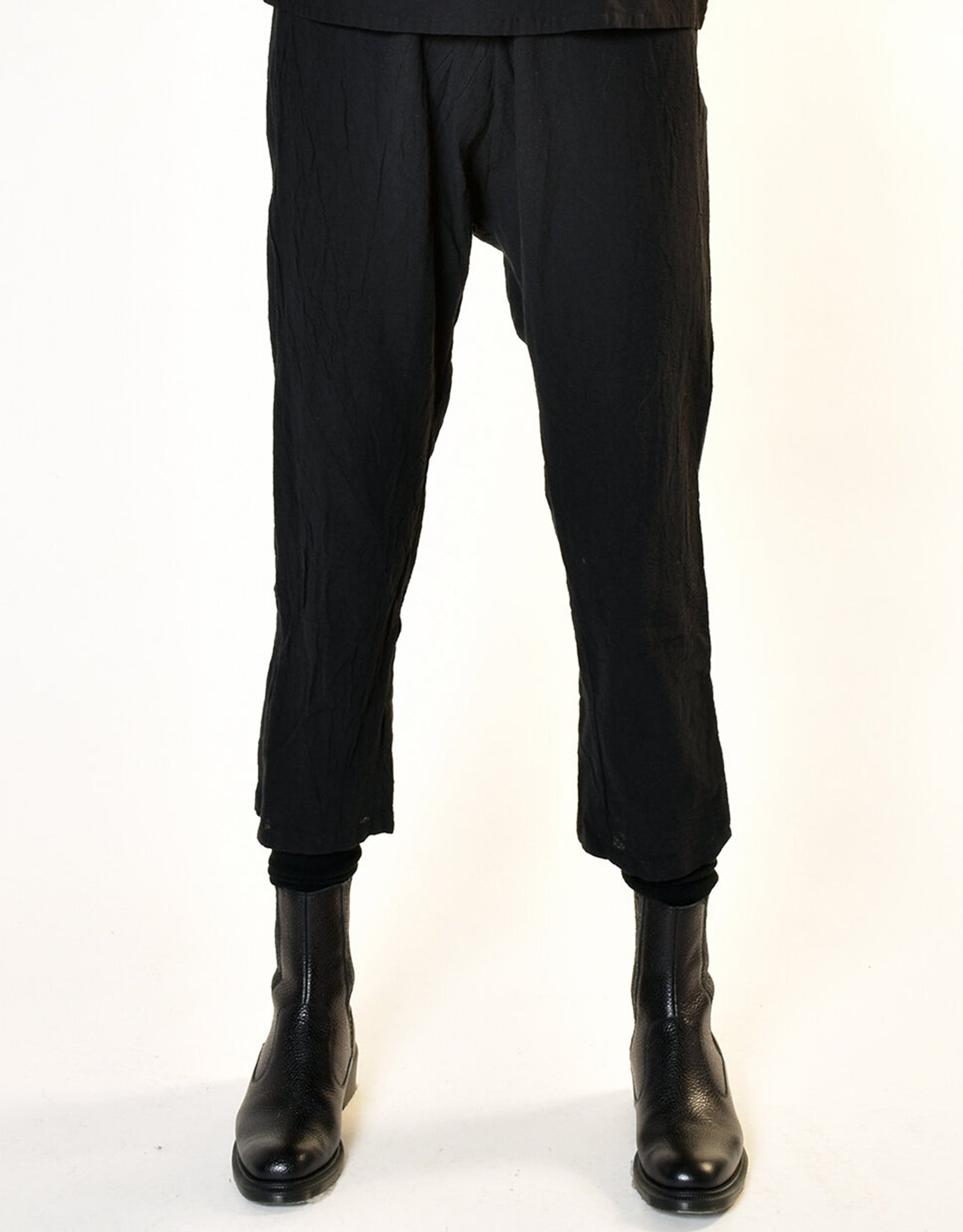 Model wears UZI NYC Coarse Cotton Drop Crotch Pant in Black. Available at FAWN Toronto.