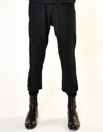 Load image into Gallery viewer, Model wears UZI NYC Coarse Cotton Drop Crotch Pant in Black. Available at FAWN Toronto.