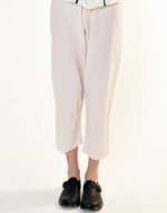Load image into Gallery viewer, Model wears UZI NYC Coarse Cotton Drop Crotch Pant in Cream. Available at FAWN Toronto.