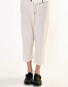 Model wears UZI NYC Coarse Cotton Drop Crotch Pant in Cream. Available at FAWN Toronto.