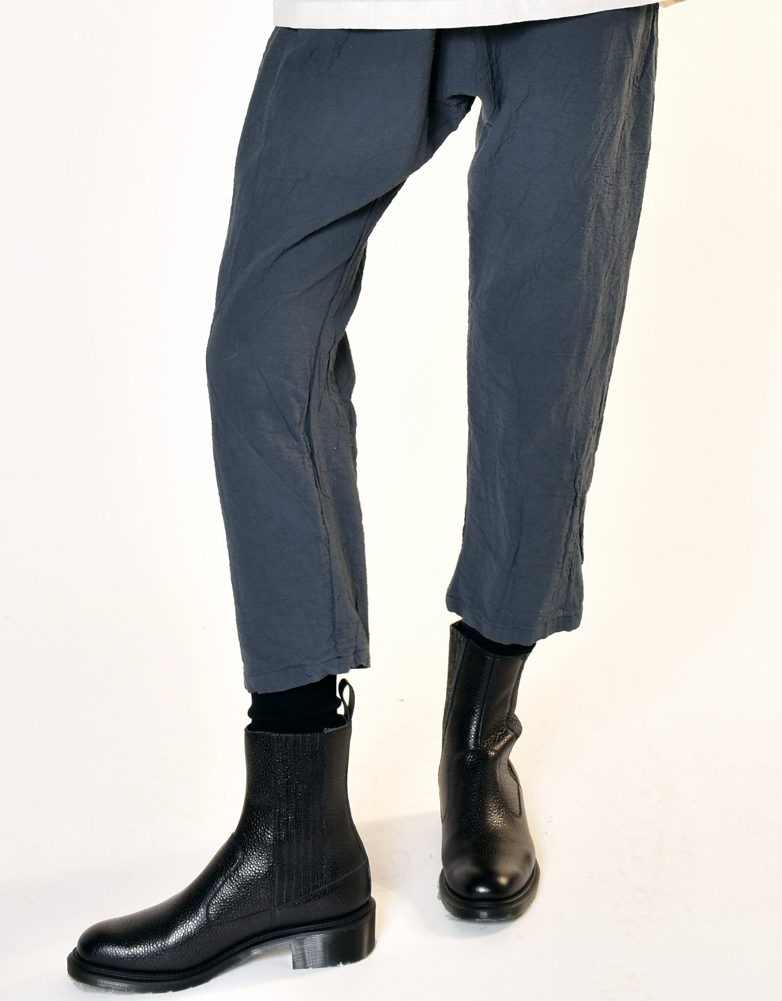 Model wears UZI NYC Coarse Cotton Drop Crotch Pant in Charcoal. Available at FAWN Toronto.