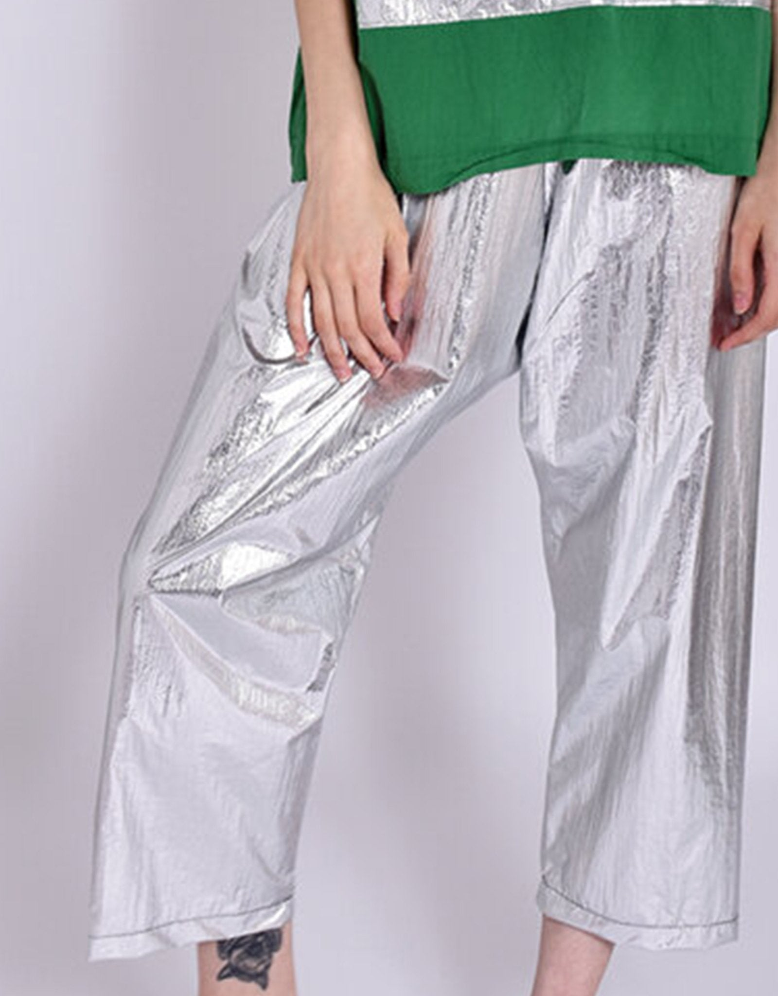 Model wears UZI NYC Coarse Cotton Drop Crotch Pant in Silver. Available at FAWN Toronto.