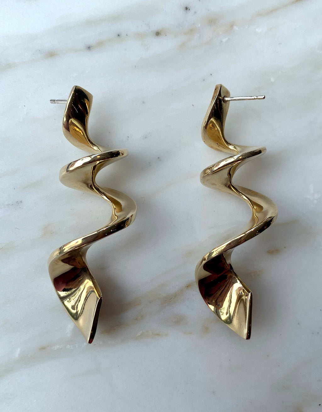 Quarry swirling brass Whorl Earring. Available at FAWN Toronto.