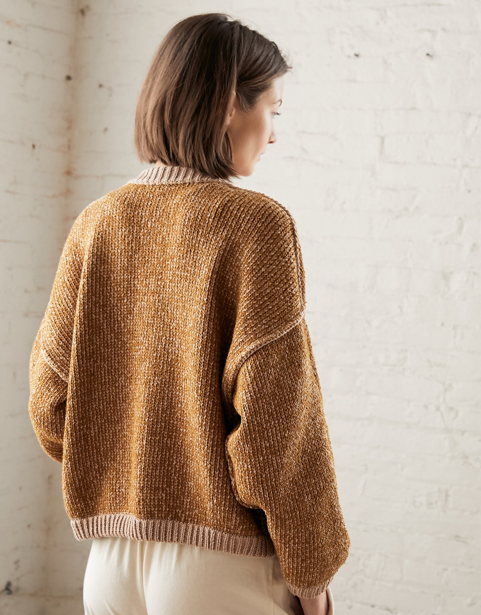 Wol Hide Box Cardigan on model, back. Available at FAWN Toronto.
