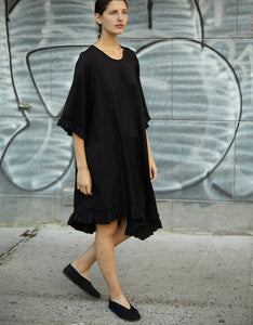 Model wears Correll Correll Curves Ruffle Dress in Black. Available at FAWN Toronto.