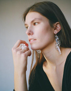 Clear Double Knot Earrings by Corey Moranis on model. Available at FAWN Toronto.
