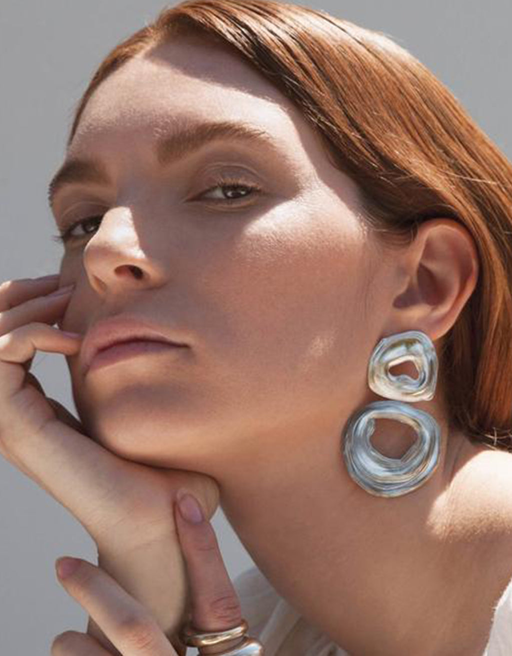 Bold, white bronze Double Whirlpool Earrings by Leigh Miller on model. Available at FAWN Toronto.