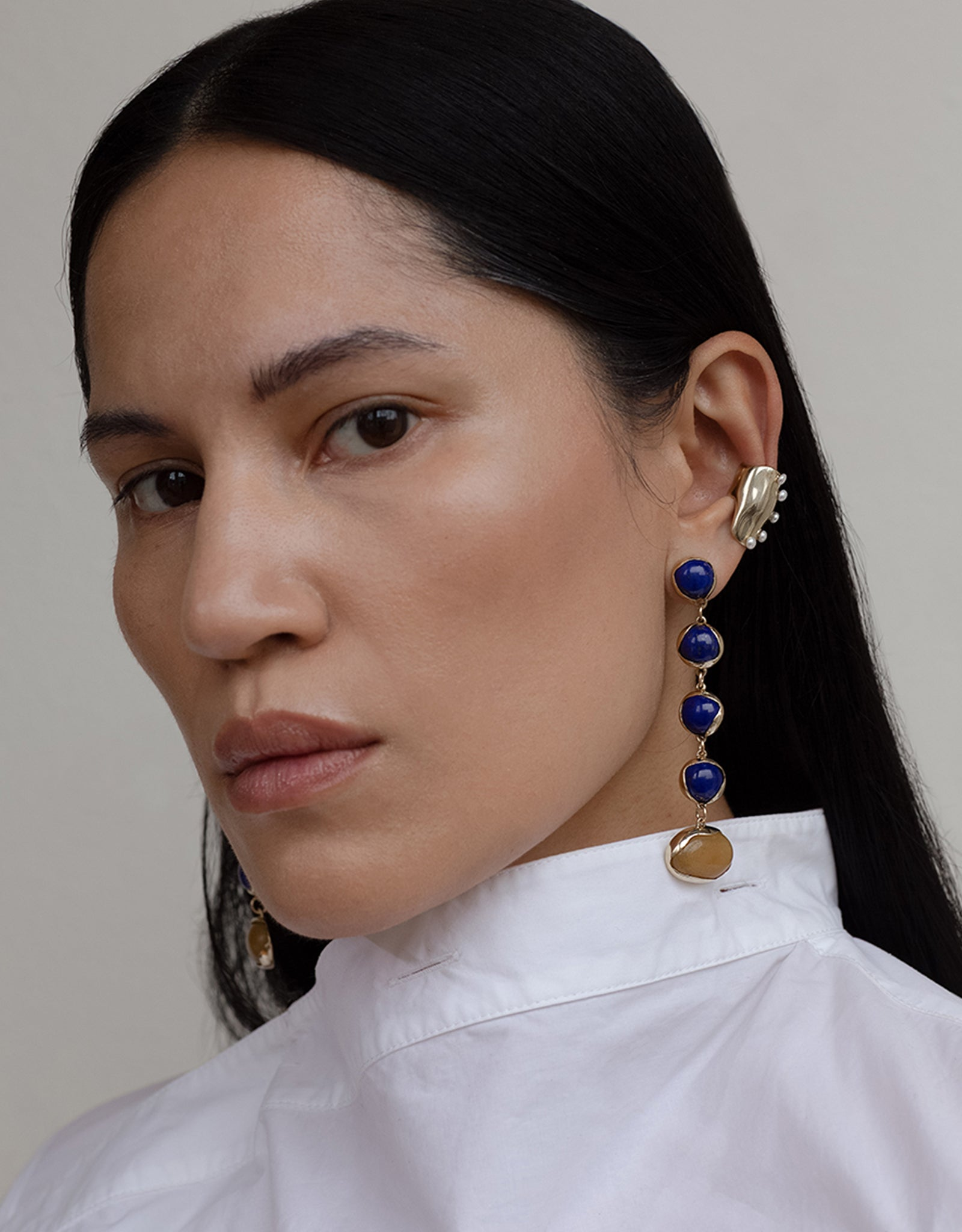 Faris dangling Festa Lapis Earrings on model. Available at FAWN Toronto.