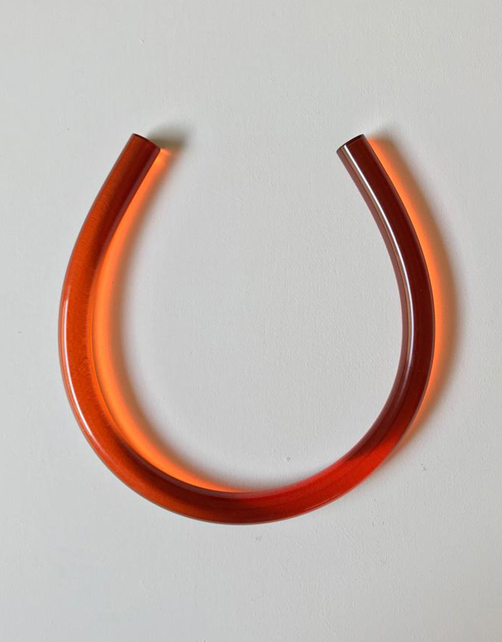 Translucent Copper Horseshoe Necklace by Corey Moranis. Available at FAWN Toronto.