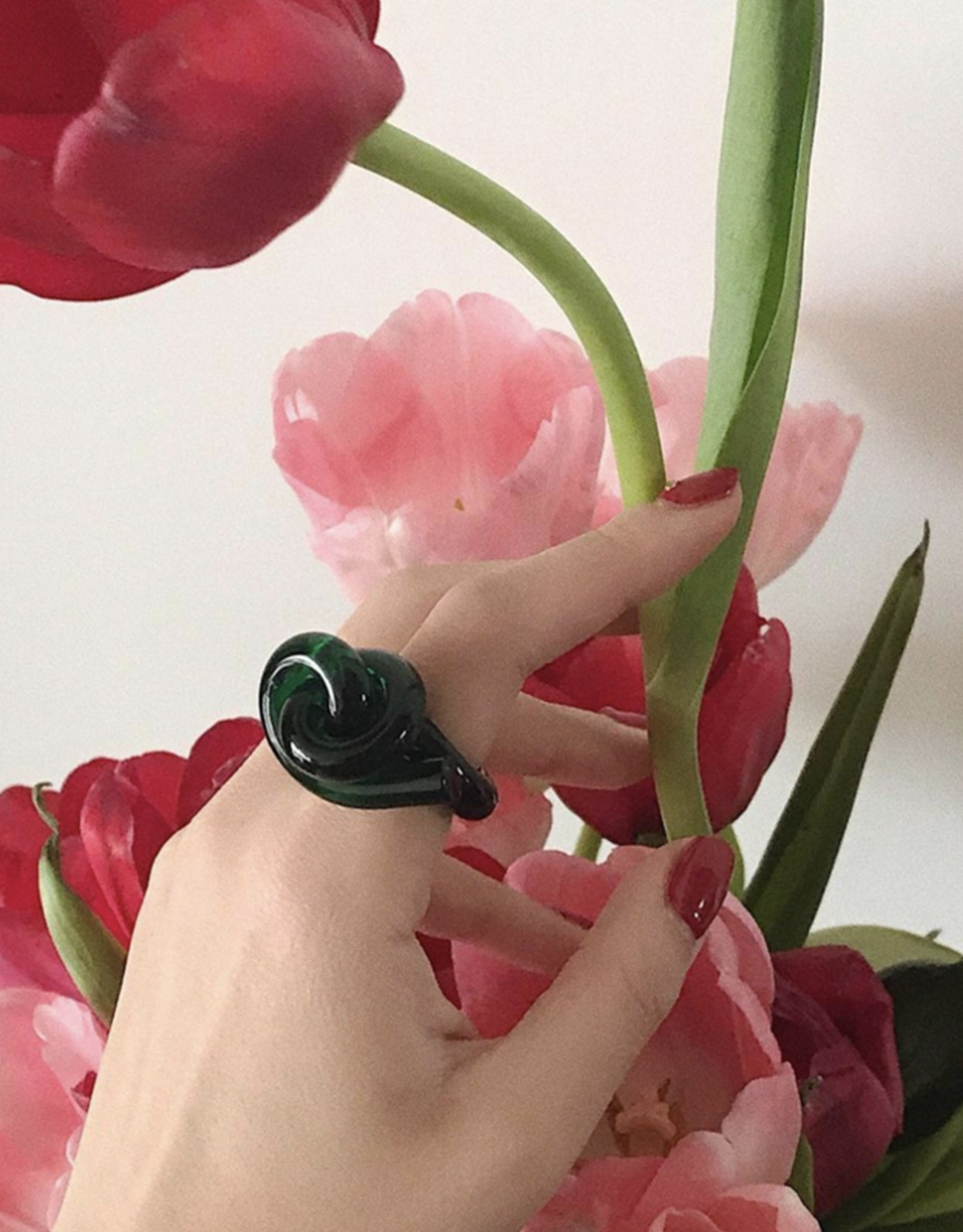 Green Knot Ring by Corey Moranis on model. Available at FAWN Toronto.