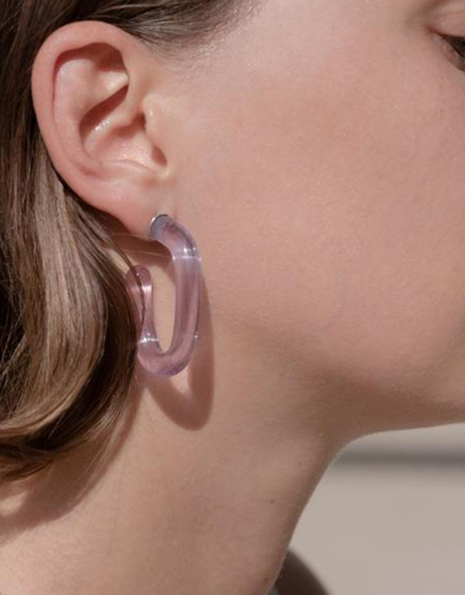 Luminous Glass Lavender Hoop Earrings by Leigh Miller on model. Available at FAWN Toronto.