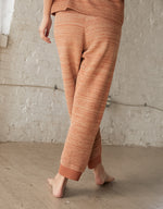 Load image into Gallery viewer, Wol Hide Mesh Jogger on model, back. Available at FAWN Toronto.
