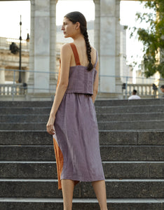 Model wears Correll Correll Olka Skirt in Lilac, back. Available at FAWN Toronto.