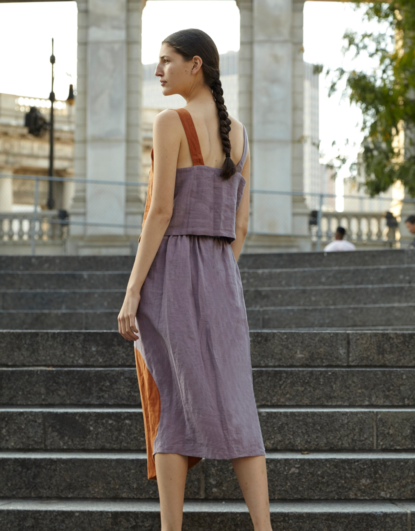 Model wears Correll Correll Olka Top in Lilac with Bronze detail, back. Available at FAWN Toronto.