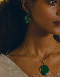 Faris bronze and malachite OVO Drops on model. Available at FAWN Toronto.