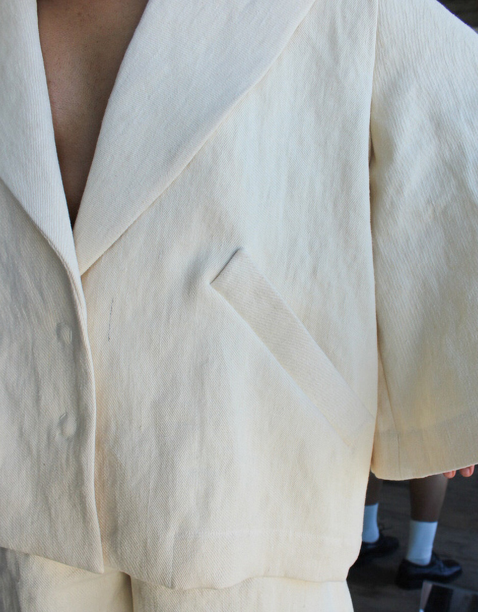 Model wears Nancy Stella Soto Rounded Sleeve Hemp Jacket in Ivory, sleeve detail. Available at FAWN Toronto.