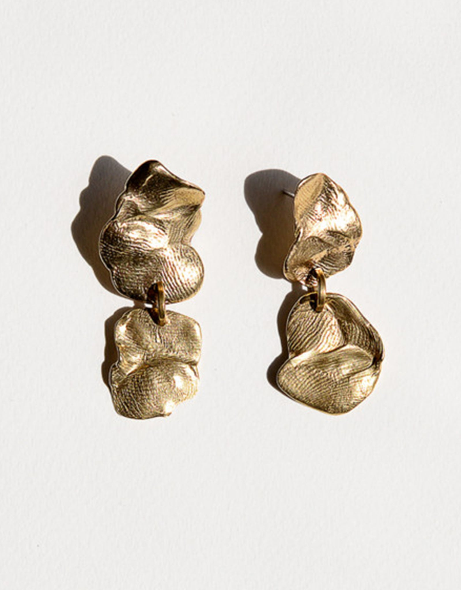 Michelle Ross brass Selene Earring. Available at FAWN Toronto.