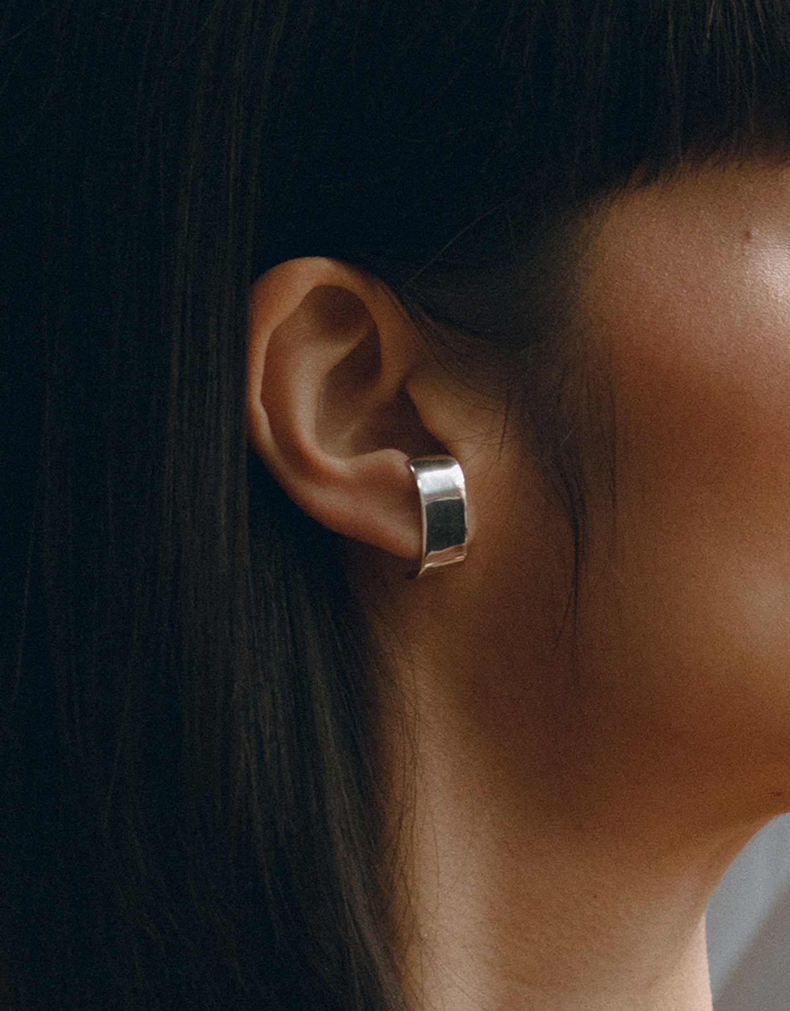 Faris silver Slope Stud Earring on model. Available at FAWN Toronto.