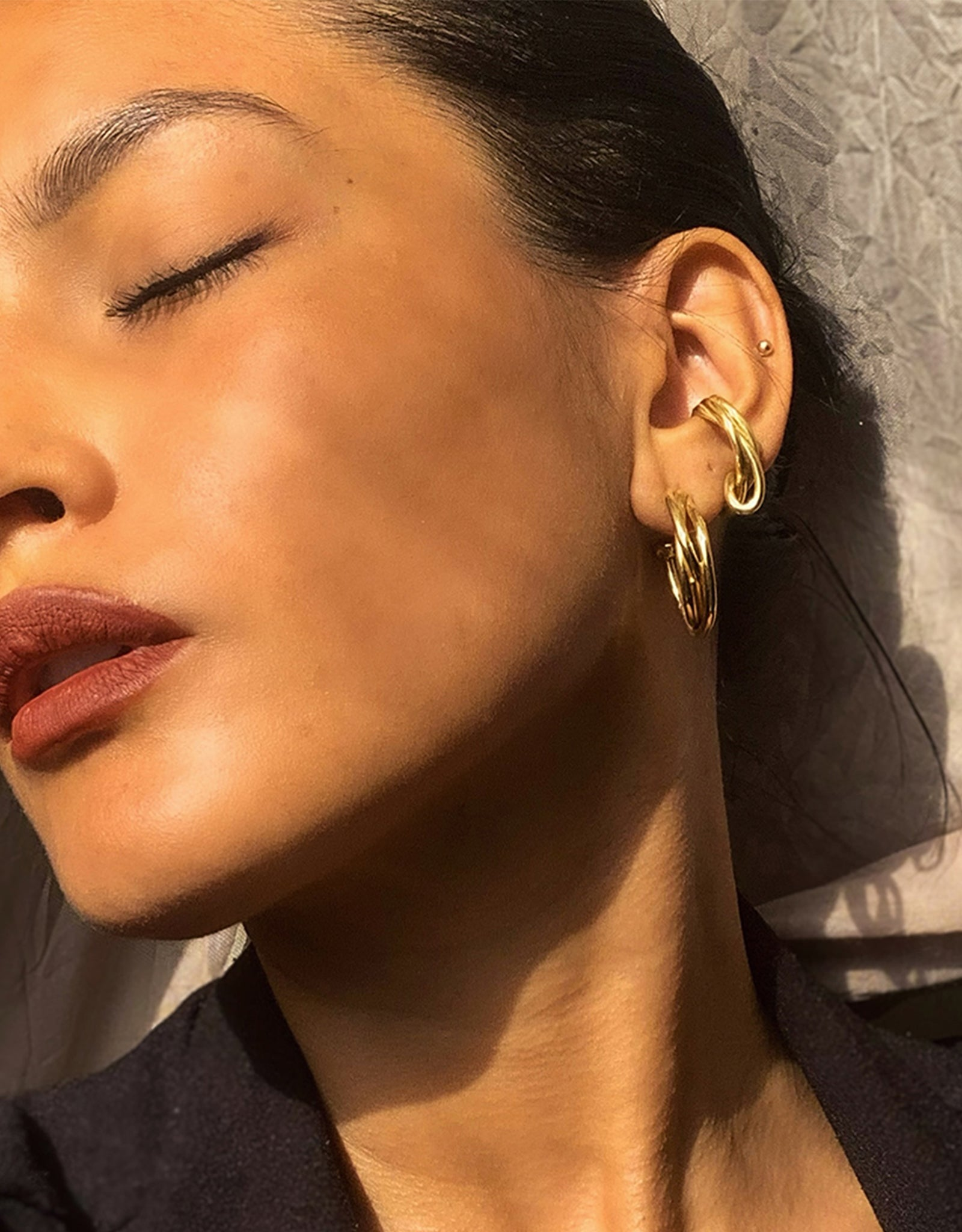 Faris bronze Tangle Ear Cuff on model. Available at FAWN Toronto.