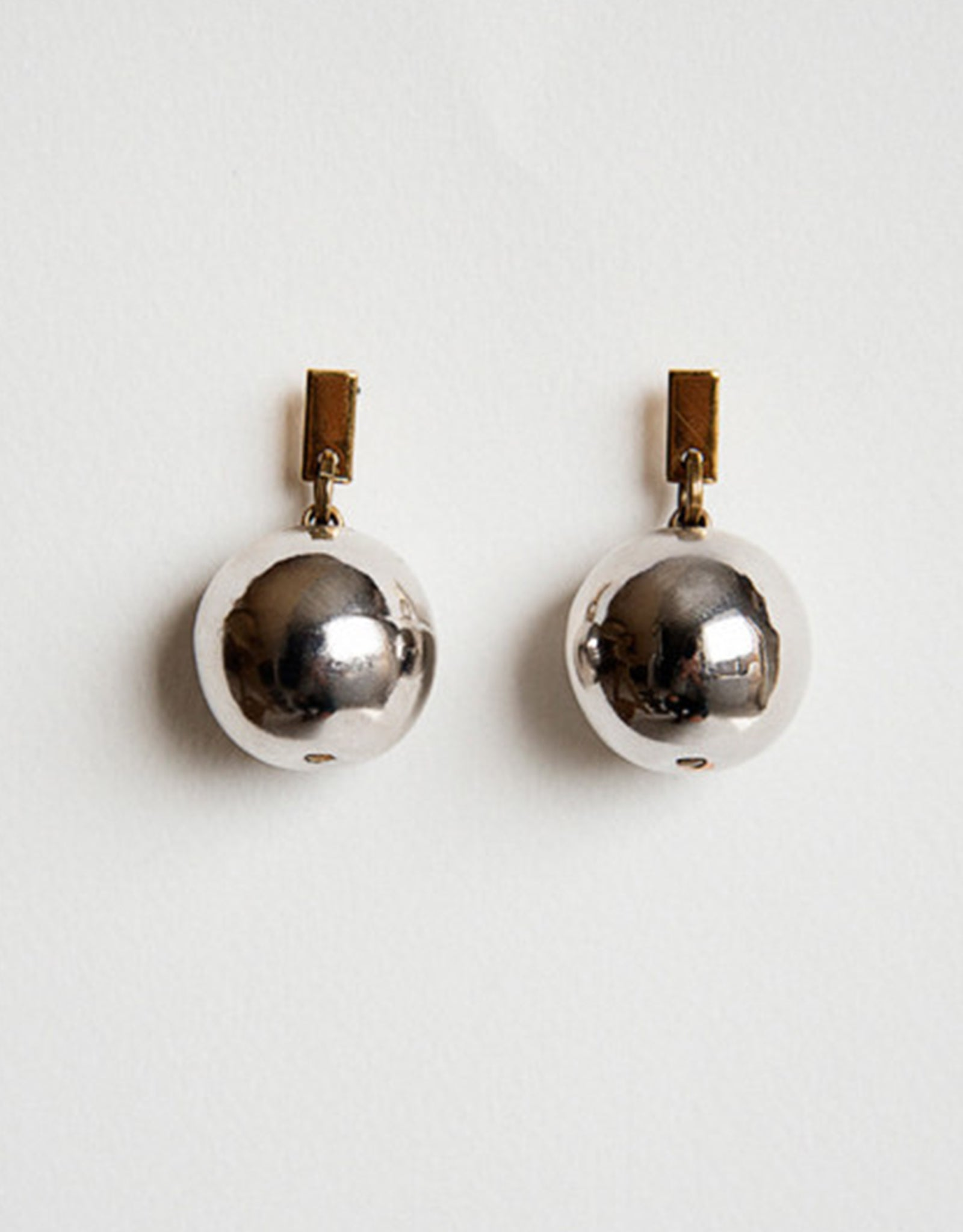 Michelle Ross gleaming rhodium plated, and gold Toma Earrings. Available at FAWN Toronto.