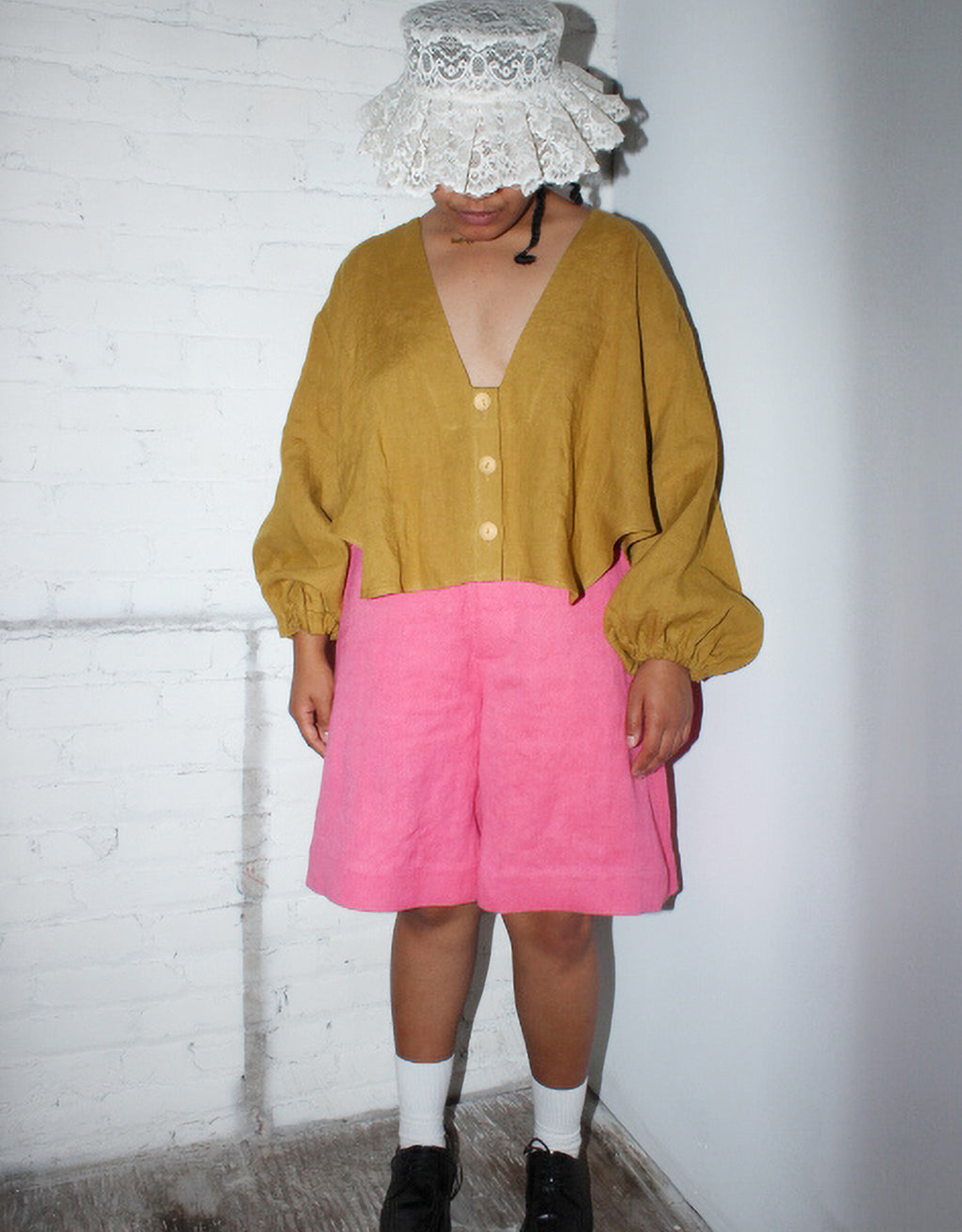Model wears Nancy Stella Soto V-Neck Cropped Shirt in Ochre.. Available at FAWN Toronto.