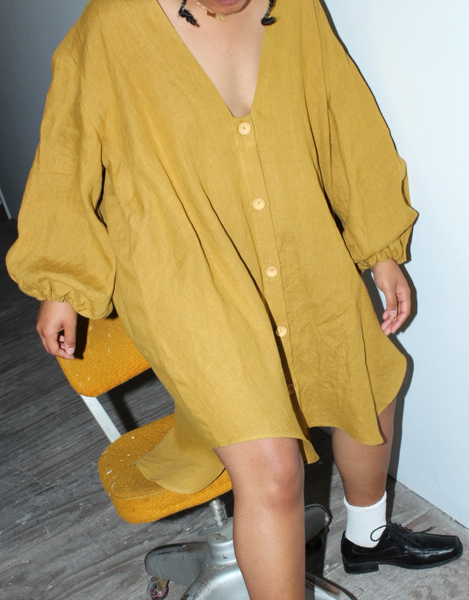 Model wears Nancy Stella Soto V-Neck Cropped Shirtdress in Ochre. Available at FAWN Toronto.