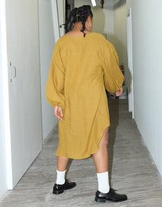 Model wears Nancy Stella Soto V-Neck Cropped Shirtdress in Ochre, back. Available at FAWN Toronto.